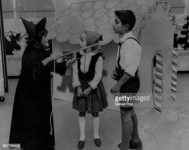Fremont Presents ' Hansel and Gretel' In this scene from 'Hansel and Gretel' the wicked witch Jeanette Veto 12110W 60th Ave accosts Gretel Marla...