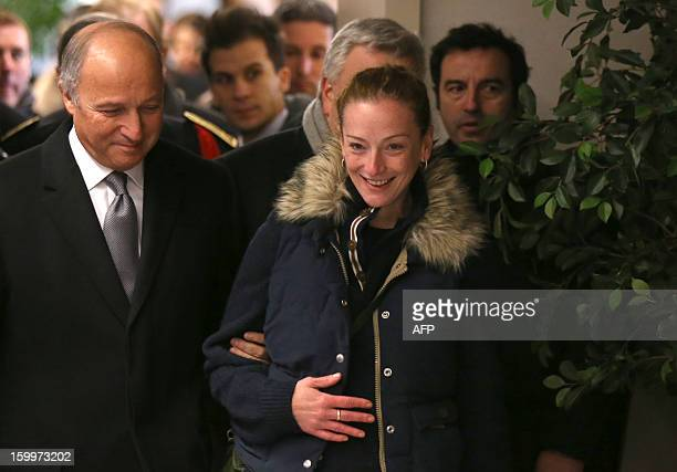 Frence's Florence Cassez flanked by French Foreign minister Laurent Fabius arrives for a press conference upon her arrival at Roissy airport on...