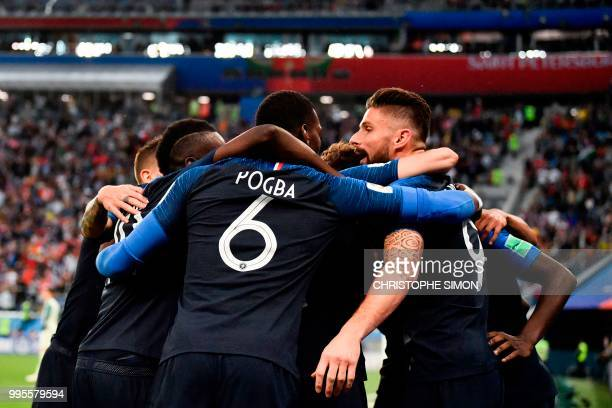 TOPSHOT Frence's players celebrate the opening goal during the Russia 2018 World Cup semifinal football match between France and Belgium at the Saint...