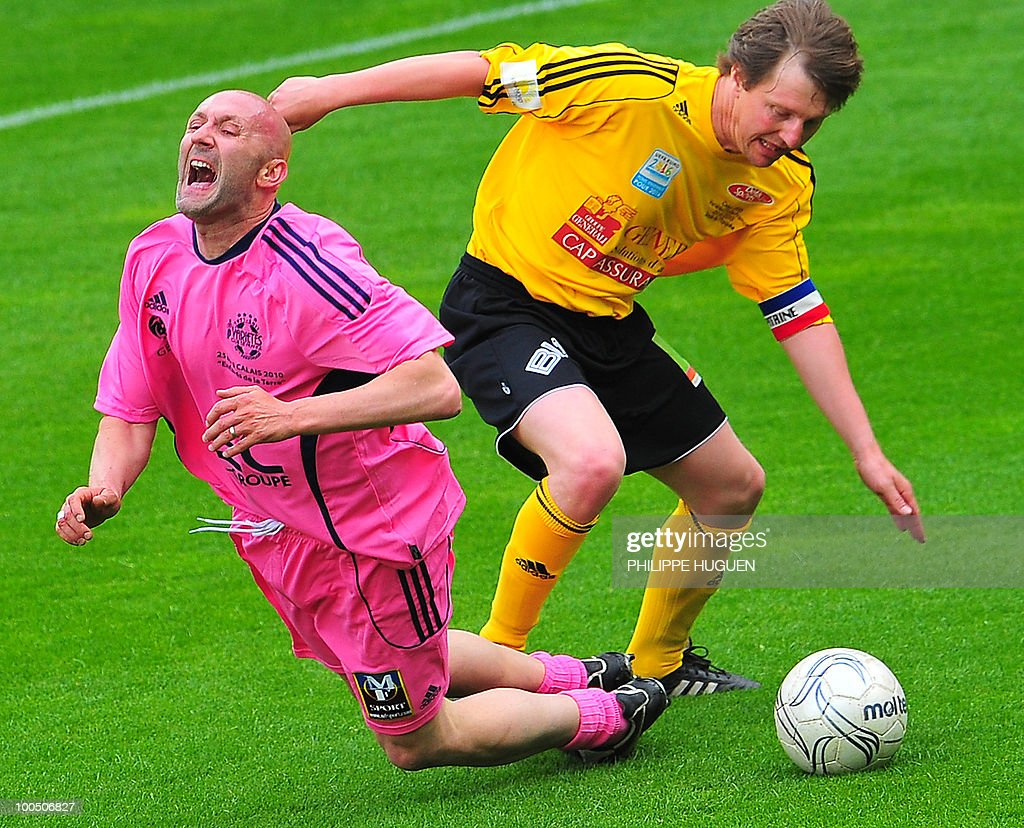 French 1998 World Cup goalkeeper Fabien Barthes (L) vies with Calais's defender Reginald Becque during the football exhibition match Calais vs. Varietes Club de France, on May 25, 2010 at the Epopee stadium in Calais, northern France. This exhibition match between Calais and a team made up of French 1998 World Cup champions stands to commemorate amateur team of Calais epic run to the final of the 2000 Coupe de France.