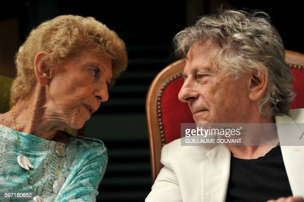French Academician Helene Carrere d'Encausse and PolishFrench director Roman Polanski speak to one another during the 21th book fair La Foret Des...