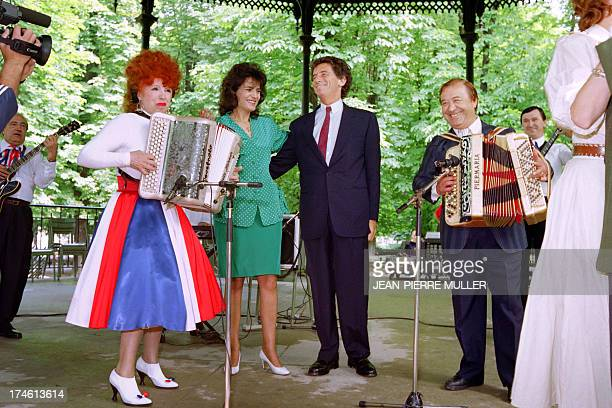 French accordionist Yvette Horner performs on July 11 1989 in the Tuileries Gardens in Paris as French Culture Minister Jack Lang and singer Linda de...