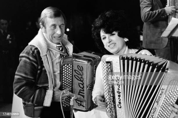 French accordionists Yvette Horner and Aimable perform during the music world's largest annual trade fair Midem on January 28 1976 in Cannes...