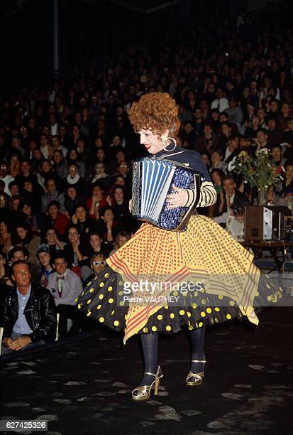 French accordionst and entertainer Yvette Horner performs for the crowd wearing a skirt and shirt by French fashion designer JeanPaul Gaultier at his...