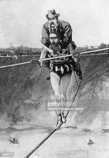 French acrobat and tightropewalker Charles Blondin born Jean Francois Gravelet crosses a 3353 metre long rope high above Niagara Falls with a man on...