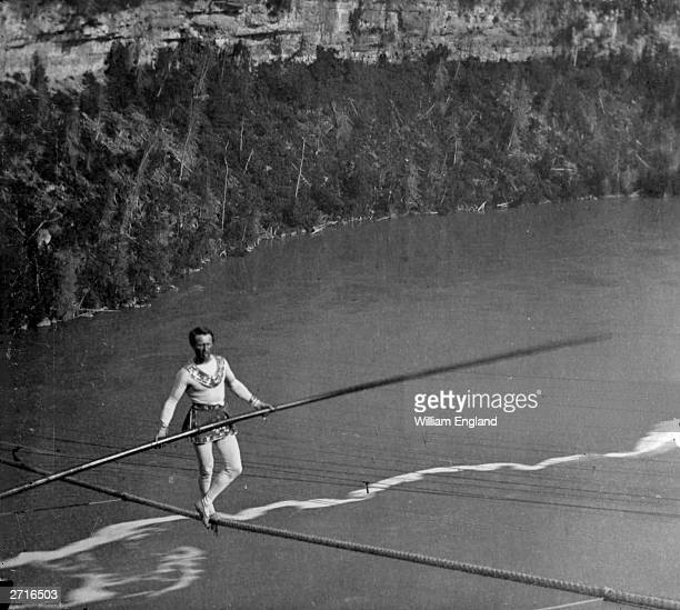 French acrobat and tightropewalker Charles Blondin real name Jean Francois Gravelet crossing Niagara on a tightrope