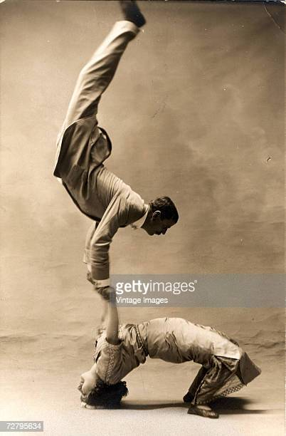 French acrobat Solea and his female assistant demonstrate their prowess at balancing for a portrait in a photographer's studio France 1900s