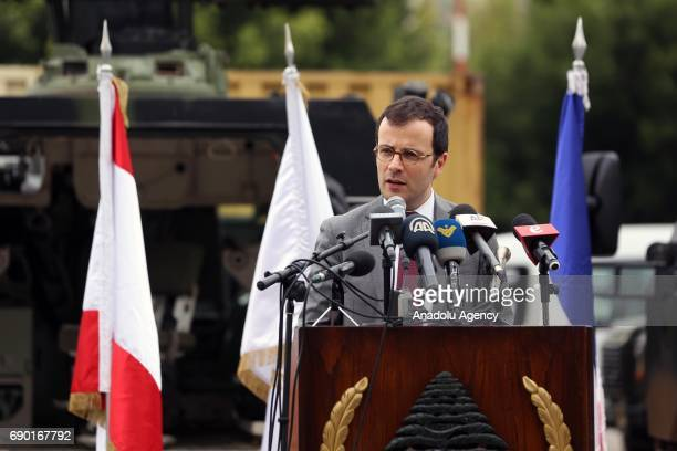French acting ambassador to Beirut Arnaud Pescheu speaks to press during the delivery of military aid provided by France with a ceremony held at an...