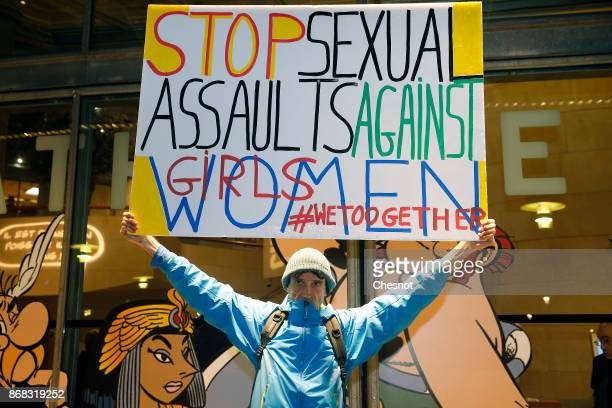 French activist holds a placard reading 'Stop sexual assaults against girls and women' during a demonstration against FrenchPolish director Roman...
