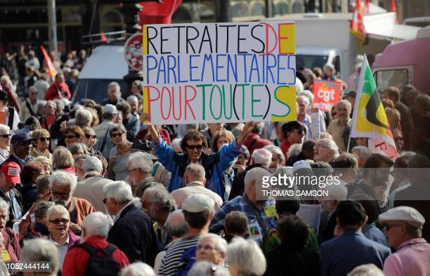 French activist JeanBaptiste Redde aka Voltuan holds a placard as he joins retirees as they take part in a rally in Paris on October 18 held to...