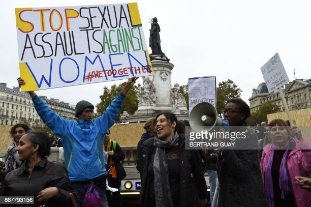 French activist JeanBaptiste Redde aka Voltuan holds a placard as protesters take part in a gathering against genderbased and sexual violence called...