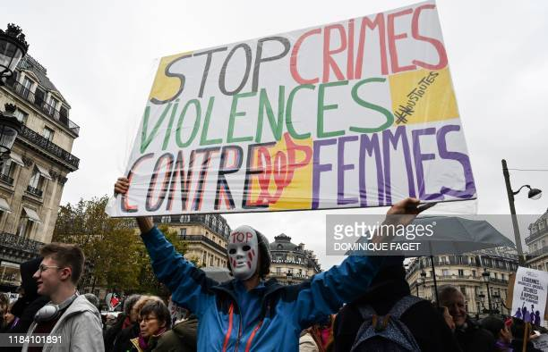 French activist JeanBaptiste Redde aka Voltuan holds up a placard reading Stop crimes against the women as he takes part in a protest during the...