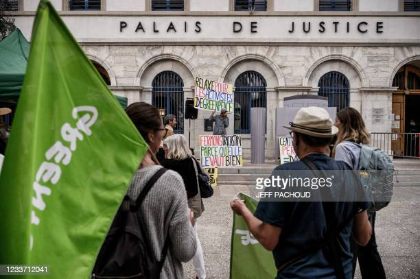 French activist Jean-Baptiste Redde also known as Voltuan demonstrates with Greenpeace members on June 29, 2021 in front of Valence courthouse, to...