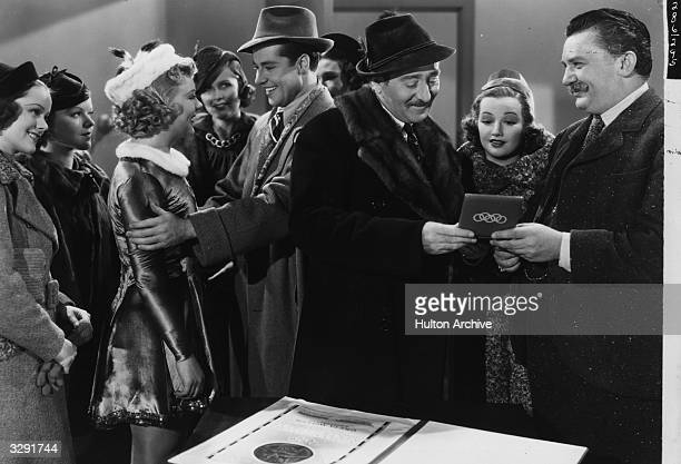 French actor Adolphe Menjou and Norwegian skating champion Sonja Henie star in the 20th Century Fox comedy 'One In A Million', directed by Sydney...