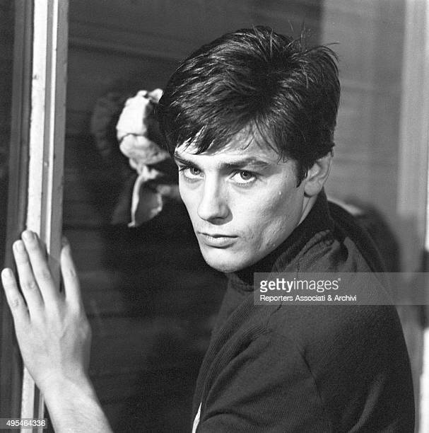 French actor Alain Delon acting leaned against a door in the film Rocco and His Brothers 1960