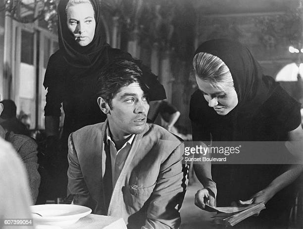 French actor Alain Delon and American actresses Lola Albright and Jane Fonda on the set of Les Felins written and directed by Rene Clement