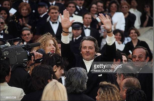 French Actor Alain Delon and artist Domiziana Giordano during the Nouvelle vague party at Cannes Film Festival in Cannes France on May 18 1990