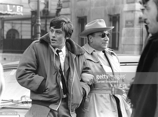 French actor Alain Delon and director and screenwriter JeanPierre Melville on the set of Melville's movie Un Flic
