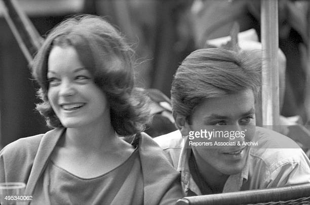 French actor Alain Delon and Germanborn French actress Romy Schneider sitting and laughing in a cafà© on Via Veneto Rome