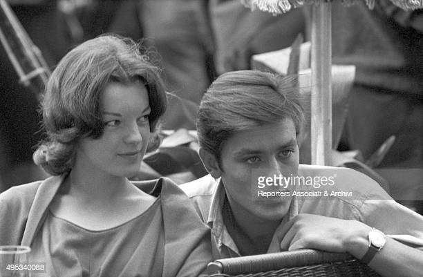 French actor Alain Delon and Germanborn French actress Romy Schneider sitting at a table of a cafà© on Via Veneto Rome