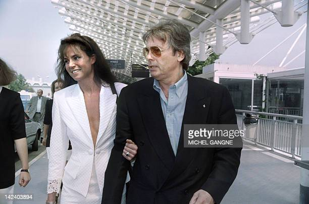 French actor Alain Delon and his Dutch model companion Rosalie Van Breemen arrive on May 8 1992 at the Nice airport to present the film 'Le retour de...