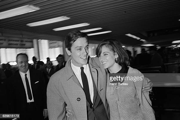 French actor Alain Delon and his wife actress Nathalie Delon at Orly Airport