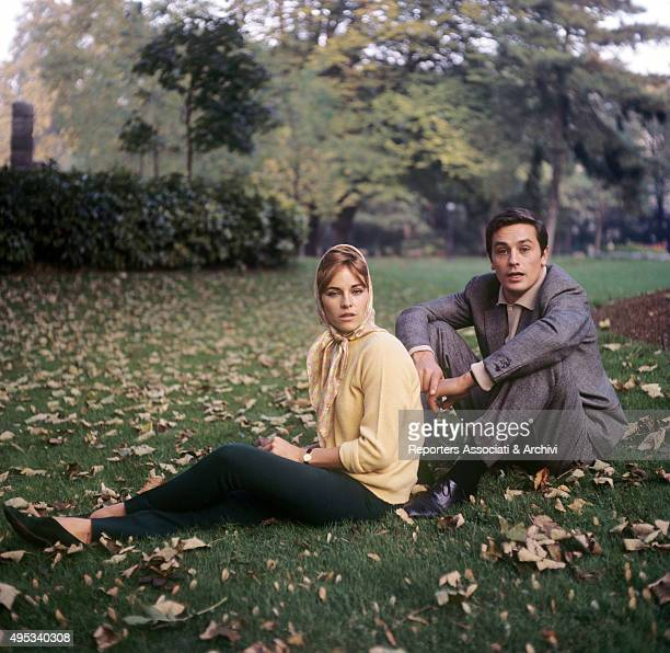 French actor Alain Delon and his wife Nathalie posing on the grass 1960s