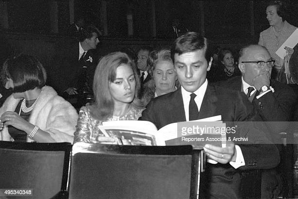 French actor Alain Delon and his wife Nathalie reading a magazine during a theatre opening night Rome 1966
