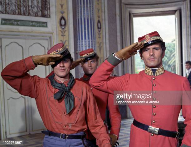 French actor Alain Delon and Italian actors Giuliano Gemma and Terence Hill wearing Garibaldi's army uniforms in a scene from the film The Leopard....