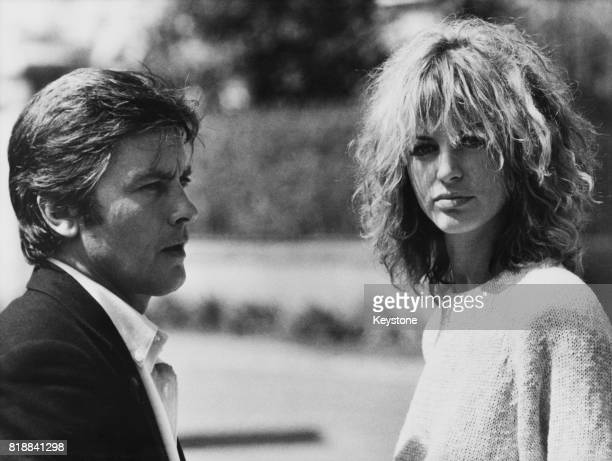 French actor Alain Delon and Italian actress Dalila Di Lazzaro on the set of the film 'Trois hommes à abattre', , France, 8th October 1980.