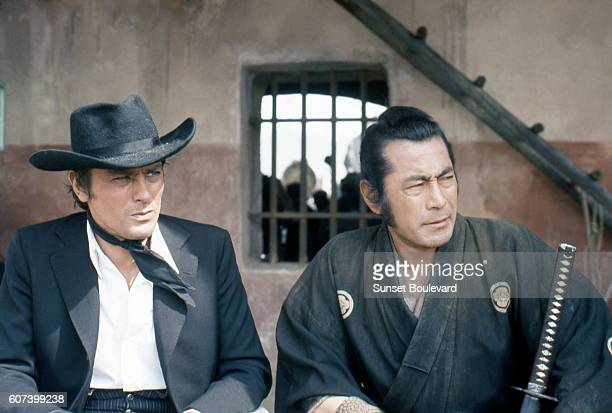 French actor Alain Delon and Japanese actor Toshiro Mifune on the set of Soleil Rouge directed by British Terence Young