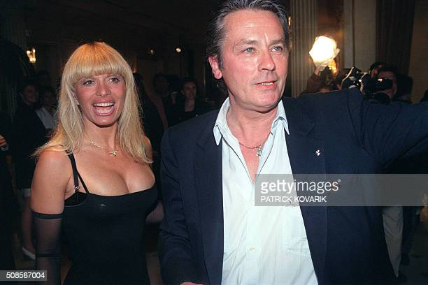 French actor Alain Delon and Lova Moor, dancer at the Crazy Horse Saloon strip club, take part to the 40th anniversary of the Parisian cabaret at the...