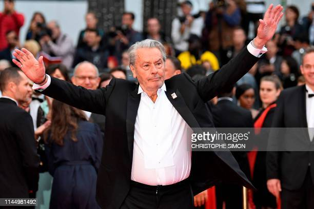 TOPSHOT French actor Alain Delon arrives to be awarded with an Honorary Palme d'Or at the 72nd edition of the Cannes Film Festival in Cannes southern...