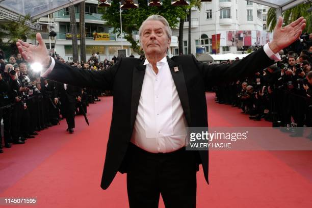 French actor Alain Delon arrives to be awarded with an Honorary Palme d'Or at the 72nd edition of the Cannes Film Festival in Cannes southern France...
