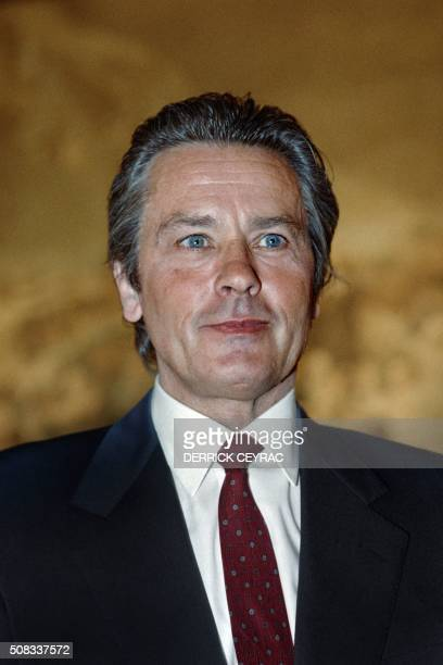 French actor Alain Delon attends the TV broadcast 'Questions à domicile' on French Channel TF1 at the Jeu de Paume in Versailles on January 19 1989...
