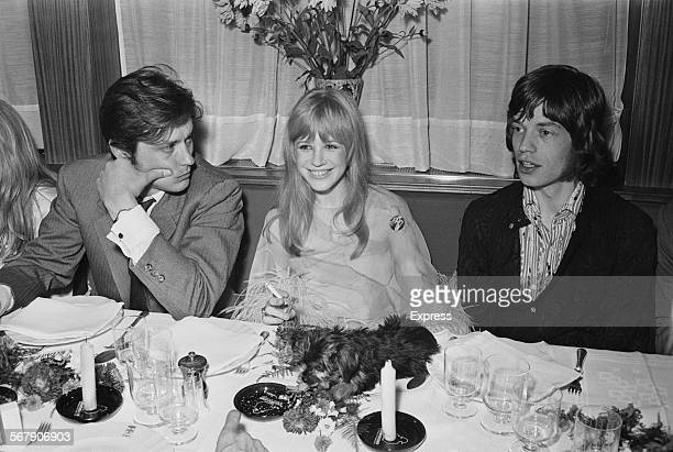 French actor Alain Delon, English singer and actress Marianne Faithfull, and English singer Mick Jagger at a meeting with film director Jack Cardiff...