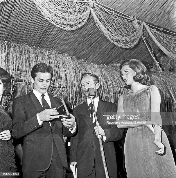 French actor Alain Delon getting the 'Ciak d'oro' award during the awarding ceremony in a club in Torvaianica on the coast of Lazio Torvaianica July...