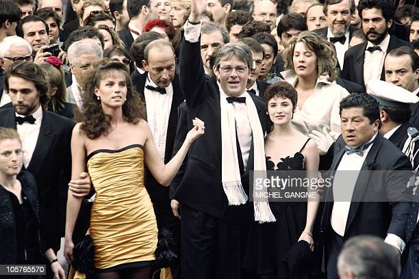 French actor Alain Delon his film partner Elsa and his Dutch model companion Rosalie Van Breemen arrive on May 8 1992 at the Cannes Film Festival...