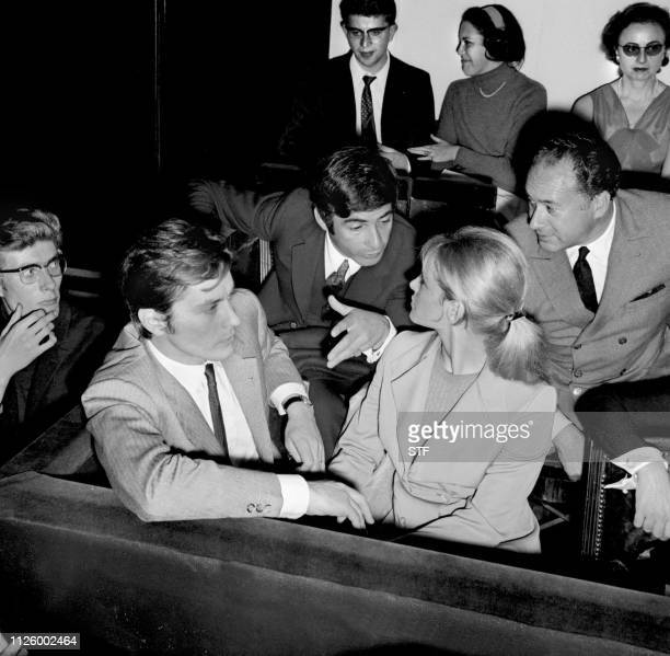 French actor Alain Delon his wife Nathalie actor JeanClaude Brialy attend the premiere of Léo Ferré at Bobino on septembre 21 1967