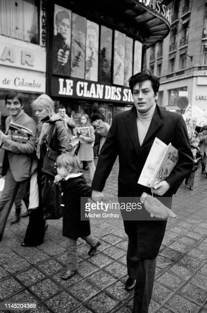 "French actor Alain Delon, his wife Nathalie Delon and their son Anthony arriving at the premiere of ""Tintin et le temple du soleil"""