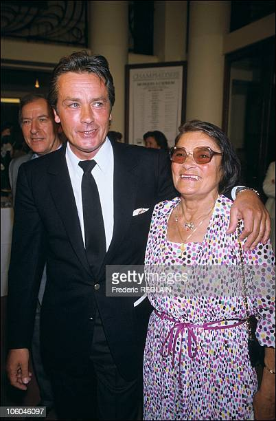 French actor Alain Delon is pictured with his mother as he receives the medal of Order of Arts and Letters from Jack Lang French Culture Minister on...