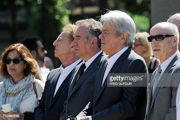 French actor Alain Delon MoDem centrist party leader Francois Bayrou and French journalist Robert Namias and his wife Anne Barrere attend the funeral...
