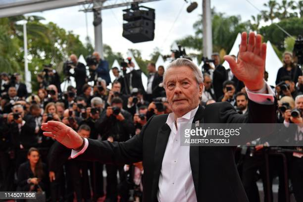 French actor Alain Delon poses as he arrives to be awarded with an Honorary Palme d'Or at the 72nd edition of the Cannes Film Festival in Cannes...