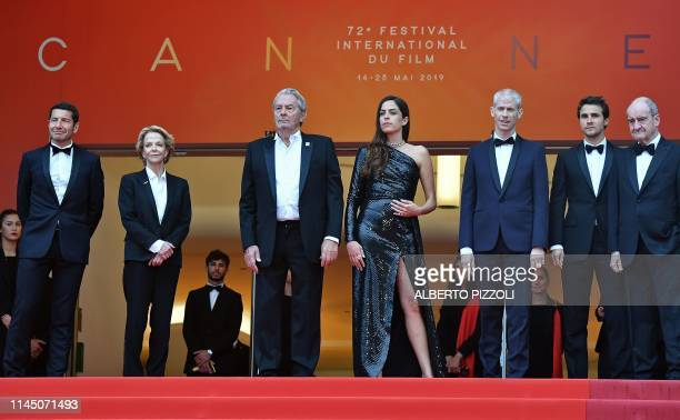 French actor Alain Delon poses as he arrives with his daughter Anouchka Delon her partner Julien Dereims to be awarded with an Honorary Palme d'Or as...