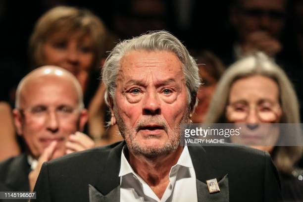 French actor Alain Delon reacts as he is awarded with an Honorary Palme d'Or at the 72nd edition of the Cannes Film Festival in Cannes southern...