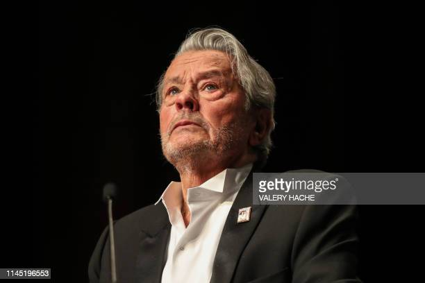French actor Alain Delon reacts as he is awarded with an Honorary Palme d'Or at the 72nd edition of the Cannes Film Festival in Cannes, southern...