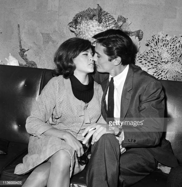 French actor Alain Delon shown in a photo dated 28 April 1965 kissing his wife Nathalie on his arrival at Orly Airport