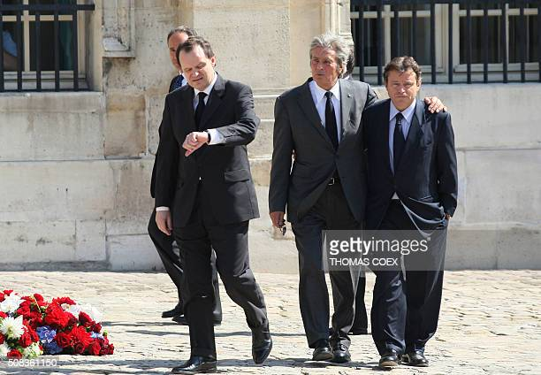 French actor Alain Delon speak with Olivier and Nicolas Barre as he arrives to attend the funeral ceremony of former French Prime Minister Raymond...