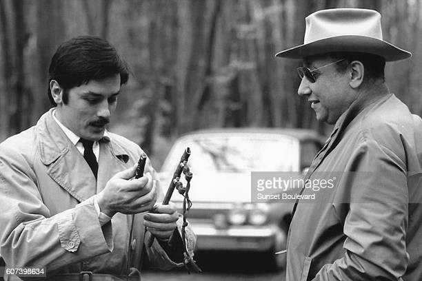 French actor Alain Delon with director and screenwriter JeanPierre Melville on the set of his movie Le Cercle Rouge