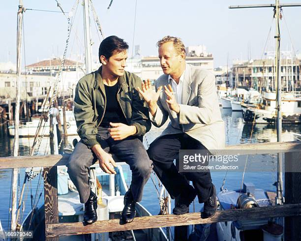 French actor Alain Delon with director Ralph Nelson at Fisherman's Wharf in San Francisco during the filming of 'Once A Thief' 1965